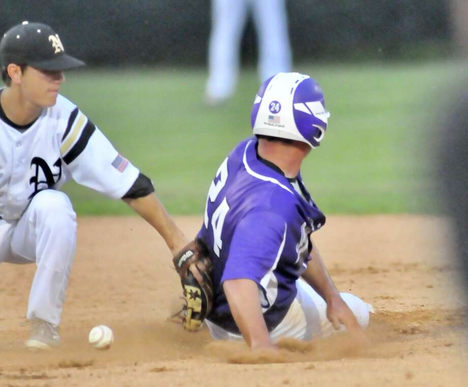 Port Neches-Groves' Holden Lane slides safely into second base on a successful steal as Nederland shortstop Landon Hiltz mishandles the throw from catcher Case Babin during the top of the second inning Tuesday, March 28, 2017, at Metreyeon-Delahoussaye Field in Nederland. Mike Tobias/The Enterprise Photo: Mike Tobias/The Enterprise