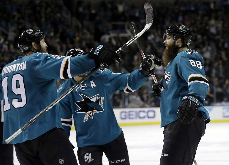 San Jose's Brent Burns (right) celebrates with teammates Patrick Marleau and Brent Burns after scoring the game-winning goal in overtime against the New York Rangers. Photo: Marcio Jose Sanchez, Associated Press