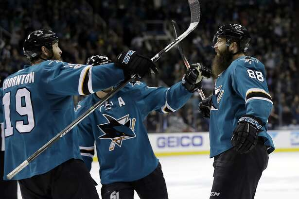 San Jose Sharks' Brent Burns (88), right, celebrates with teammates after scoring the game-winning goal during overtime of an NHL hockey game against the New York Rangers Tuesday, March 28, 2017, in San Jose, Calif. (AP Photo/Marcio Jose Sanchez)