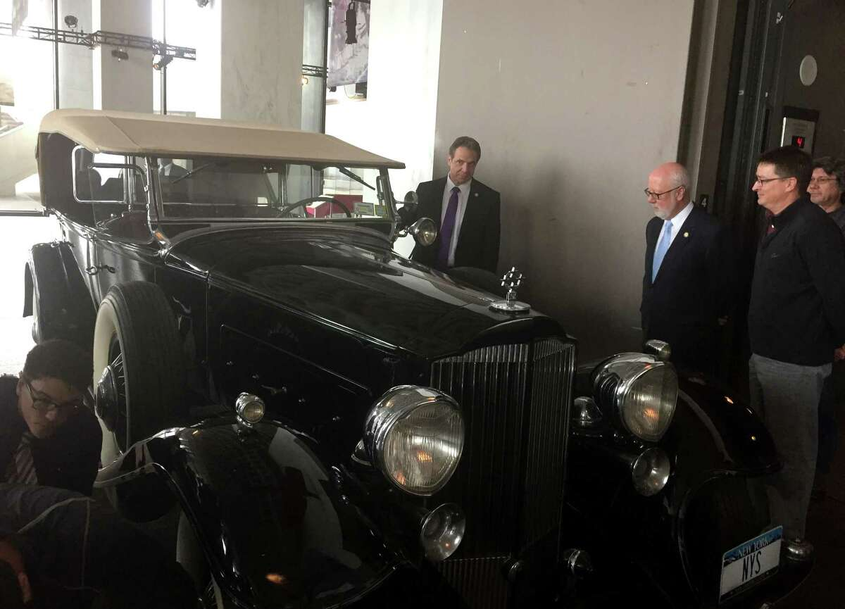 Gov. Andrew Cuomo looks over a 1932 Packard Phaeton used by former Gov. Franklin D. Roosevelt for his use in Albany on Tuesday, March 28, 2017, in Albany, N.Y. When Roosevelt was elected to the Presidency, the vehicle became part of the state fleet. Cuomo said the car will be repaired so it can be used for ceremonial jaunts ? such as, Cuomo suggested, the scheduled opening of the new Tappan Zee Bridge replacement in 2018. (Casey Seiler/Times Union)