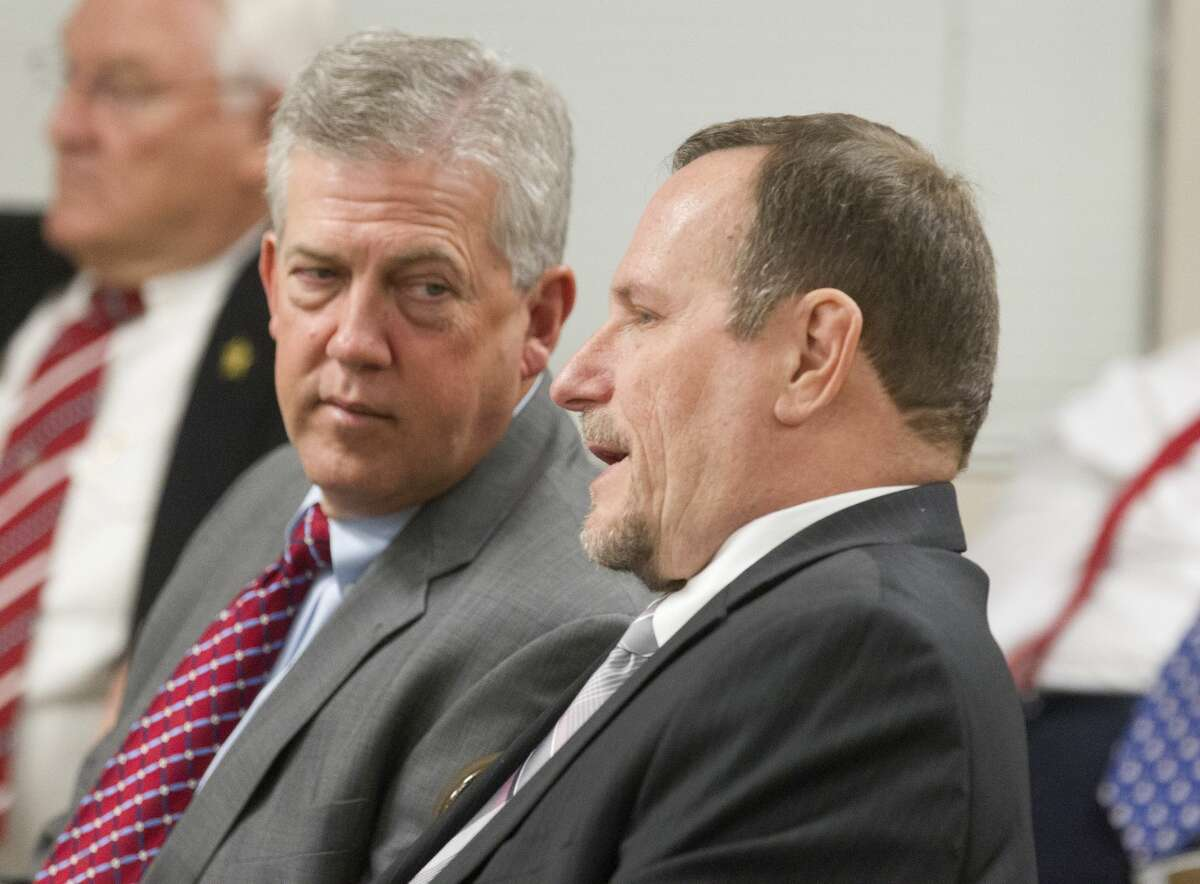Montgomery County Judge Craig Doyal, left, talks to political consultant Marc Davenport before a hearing on the constitutionality of a section of the Texas Open Meetings Act on March 29 in Conroe. A judge dismissed indictments against Doyal, Davenport and Commissioner Charlie Riley.