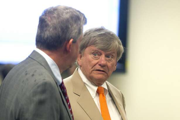 Houston defense attorney Rusty Hardin, right, visits with his client, Montgomery County Judge Craig Doyal, before a hearing on the constitutionality of the Texas Open Meetings Act in the 221st state District Court at the Lee G. Alworth Building on Wednesday, March 29, 2017 in Conroe. Visiting 221st state District Court Judge Randy Clap heard arguments regarding TOMA in connection to the upcoming trial of two members of Montgomery County Commissioners Court and a political consultant for allegedly conspiring to circumvent the act.