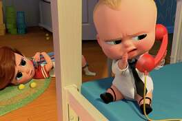 """This image released by DreamWorks Animation shows characters Tim, voiced by Miles Bakshi, and Boss Baby, voiced by Alec Baldwin in a scene from the animated film, """"The Boss Baby."""" (DreamWorks Animation via AP)"""