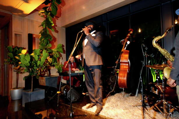 "Gregory Porter delights guests during dinner at ""Krug Journey"" in the home of Becca Cason Thrash on Tuesday, March 28, 2017, in Memorial. (Annie Mulligan / Freelance)"