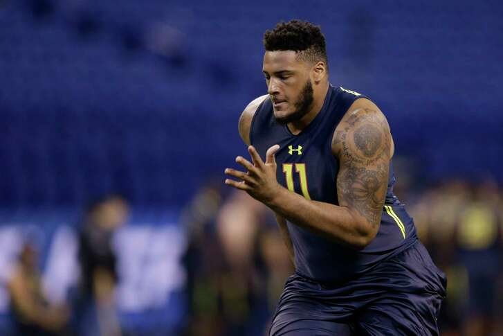 Bucknell offensive lineman Julie'N Davenport runs a drill at the NFL football scouting combine in Indianapolis, Friday, March 3, 2017. (AP Photo/Michael Conroy)