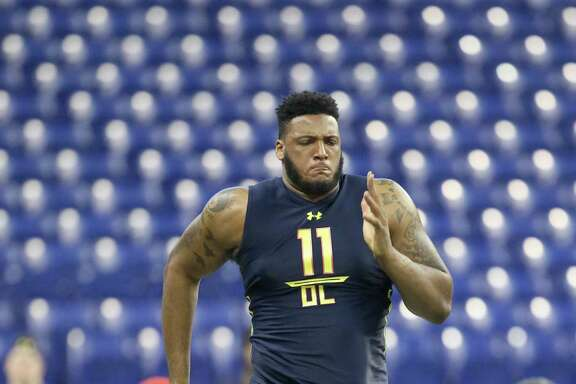 Bucknell offensive tackle Julie'N Davenport competes in the 40-yard dash at the 2017 NFL football scouting combine Friday, March 3, 2017, in Indianapolis. (AP Photo/Gregory Payan)