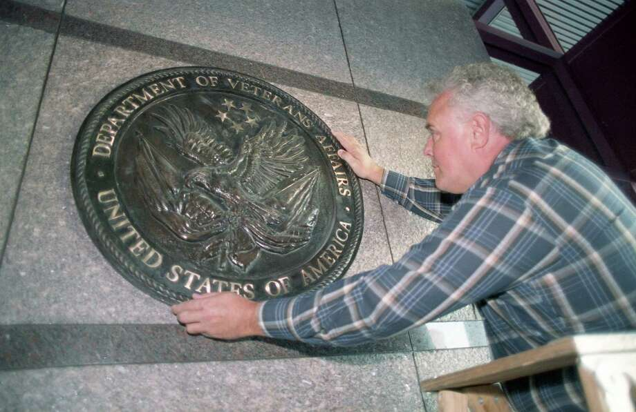 10/26/1990 - Construction coordinator Robert Woodyard adjusts the new seal on the Houston Veterans Affairs Medical Center, 2002 Holcombe. Under construction since 1986, the medical center will replace the aging and poorly designed Veterans Administration Hospital. Photo: Larry Reese, HC Staff / Houston Chronicle / Houston Chronicle