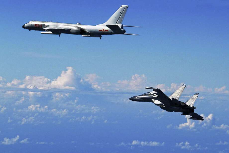 FILE - In this Sept. 25, 2016 file photo released by China's Xinhua News Agency, a Chinese People's Liberation Army Air Force Su-30 fighter, right, flies along with a H-6K bomber as they take part in a drill near the East China Sea. While the U.S. military remains the dominant force in Asia and the world, China has been moving from quantity to quality and is catching up quickly in equipment, organization and capability, and is increasingly able to project power far from its shores. (Shao Jing/Xinhua via AP, File) Photo: Shao Jing, SUB / Associated Press / Xinhua