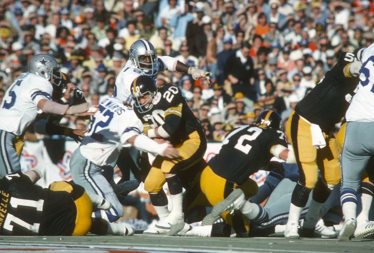 MIAMI, FL - JANUARY 18: Rocky Bleier #20 of the Pittsburgh Steelers gets tackled by Dave Edwards #52 of the Dallas Cowboys during Super Bowl X on January 18, 1976 at the Orange Bowl in Miami, Florida. The Steelers won the Super Bowl 21-7. (Photo by Focus on Sport/Getty Images)
