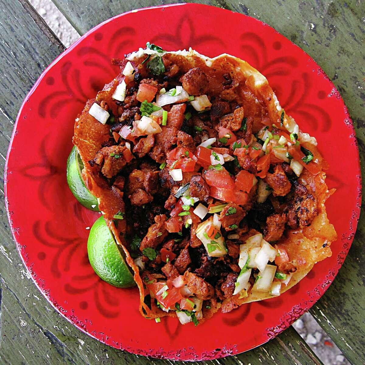 A gringa taco with al pastor, pico de gallo and cheese on a flour tortilla from Frank's Tacos.