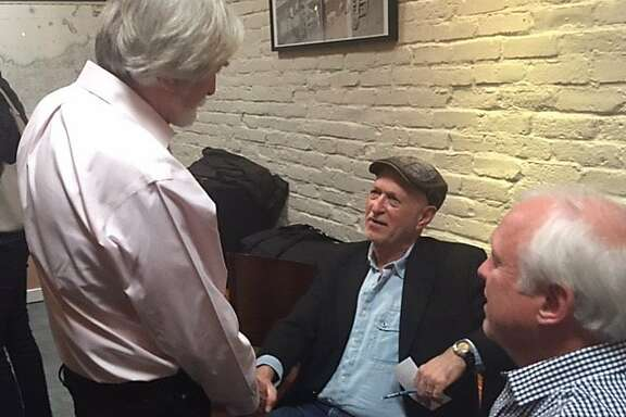 Bob Scheer talks to Dan Siegel and Stephen Talbot at fundraiser for documentary