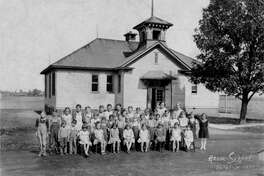 Acme School students and teachers pose for this 1933 photo in front of the school.  Acme was located just across Glen Crossing Road from present day Albert Cassens Elementary.