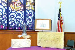 Cornerstones from previous buildings used by First Presbyterian rest on an altar table from 1881. The church is moving out of the current building on Kansas Street and building at a new site on Ridgeview Road.
