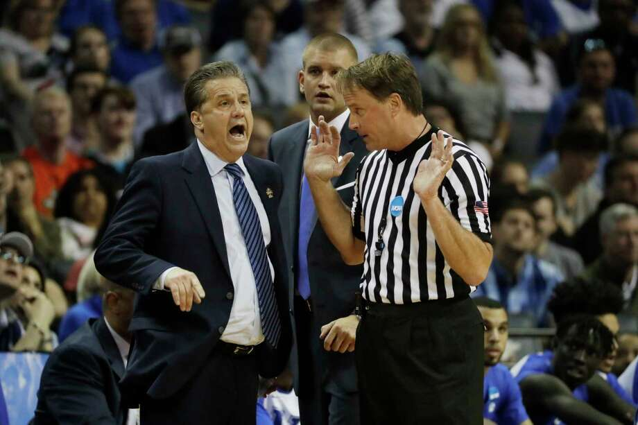 FILE - In this March 26, 2017, file photo, Kentucky head coach John Calipari argues a call with referee John Higgins in the first half of the South Regional final game against North Carolina in the NCAA college basketball tournament in Memphis, Tenn. Referee John Higgins of Omaha has contacted law enforcement to report he's received death threats after Kentucky's loss to North Carolina in the NCAA South Regional final. A person with knowledge of the situation told The Associated Press that Higgins reported threats on his home phone, which has an unlisted number, and on the office phone for his roofing company. The person requested anonymity because the investigation is ongoing. (AP Photo/Mark Humphrey, File) Photo: Mark Humphrey, Associated Press / Copyright 2017 The Associated Press. All rights reserved.