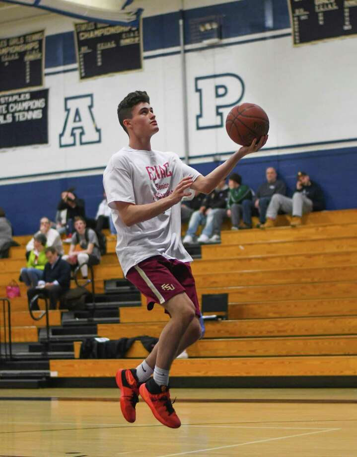 Fairfield Warde's J.J Conway goes up for a layup during the FCIAC all-star Thursday at Staples High School in Westport. Photo: Gregory Vasil / For Hearst Connecticut Media / Connecticut Post Freelance