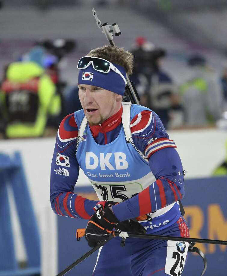 "In this Sunday, March 5, 2017 photo, Naturalized biathlete Timofei Lapshin competes during the men's 4x7.5 km relay competition for the Biathlon World Cup at the Alpensia Biathlon Centre in Pyeongchang, South Korea. Biathlete Lapshin said he's now known as ""the Russian Viktor Ahn"" after making the switch in reverse. Lapshin is a talented athlete, with a smattering of podium finishes on the World Cup circuit, but struggled to make the highly-competitive Russian team. After a super-fast naturalization process - he says the first enquiries were made only in September - he now holds a South Korean passport. (AP Photo/Lee Jin-man) Photo: Lee Jin-man / Associated Press / Copyright 2017 The Associated Press. All rights reserved."