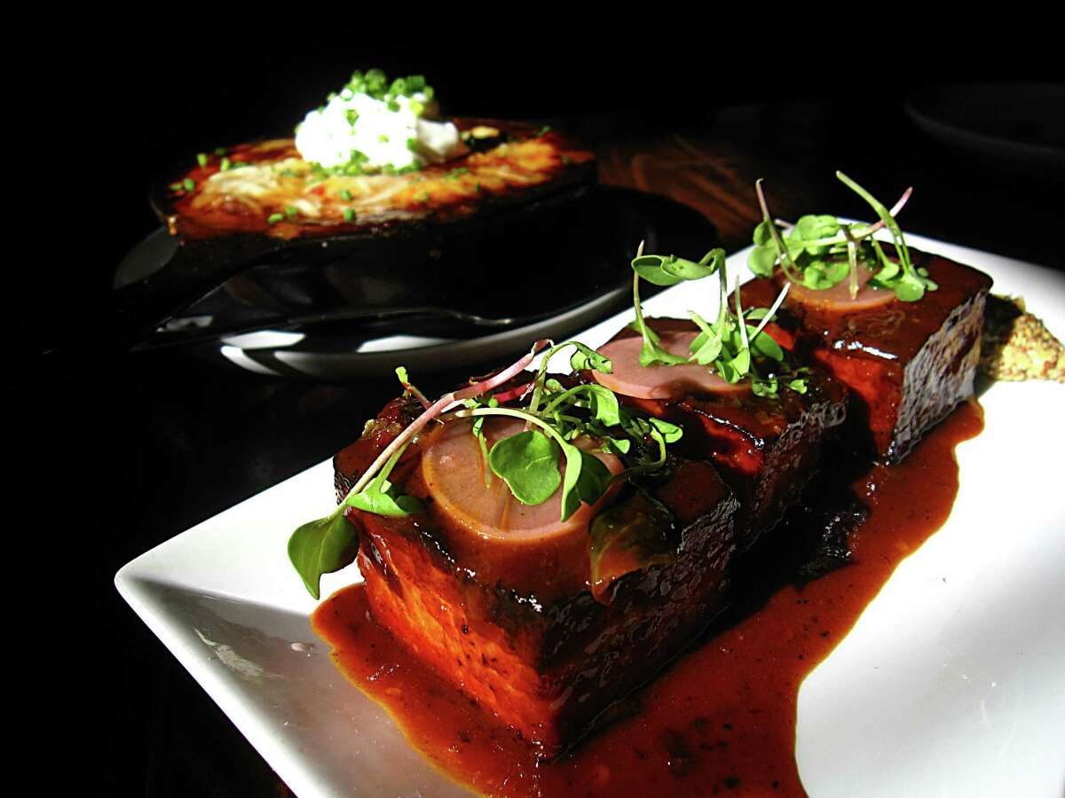 Pork belly, foreground, and cabrito at Boiler House Texas Grill & Wine Garden