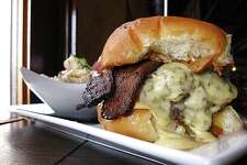The Jacky Treehorn Burger with bacon, foie gras peanut butter, poblano cheese and green tomato habanero jam. Served with Boiler House potato salad.