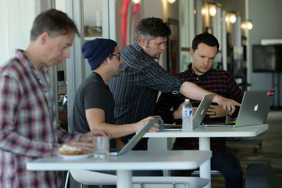 Lars Berg (left), Trenton Huey, Michael Sullivan and Brandon Loyd work at app maker Life360's S.F. offices. Photo: Santiago Mejia, The Chronicle