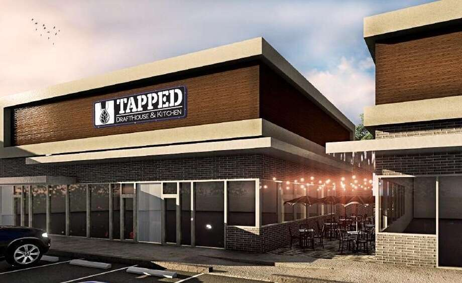 Tapped DraftHouse & Kitchen, a locally owned and operated restaurant and bar, could open in Spring as soon as May 6, although the grand opening date isn't finalized.  The neighborhood eatery boasts a 50-tap-wall and a menu highlighting American fare and bar bites. Photo: Courtesy