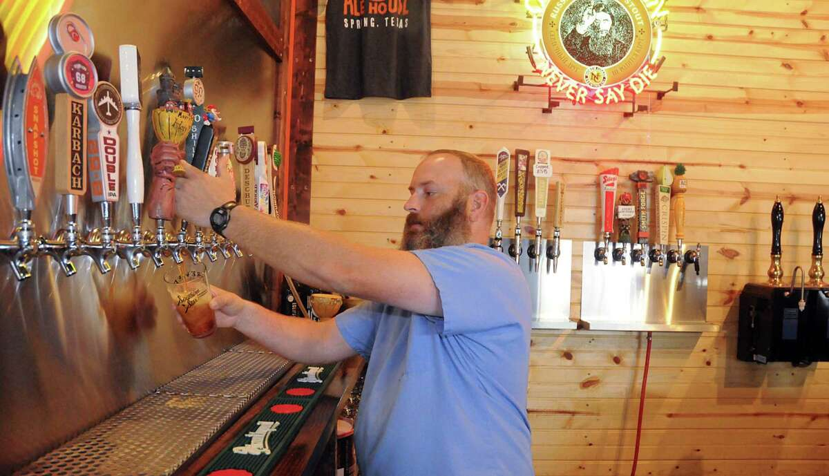 OwnerTodd Hayden, of Spring, draws a draught of one of the craft beers in the Hop Scholar Ale House, 610 Rayford Road Suite 642 in Spring. Photograph by David Hopper.