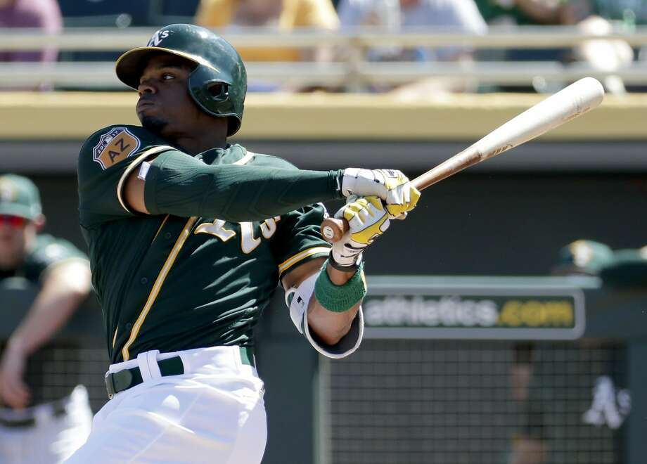 In this Saturday, March 18, 2017, photo, Oakland Athletics center fielder Rajai Davis hits against the San Diego Padres during the second inning of a spring training baseball game in Mesa, Ariz. The 36-year-old Davis brings a speed element Oakland can really use at the top of the order. (AP Photo/Matt York) Photo: Matt York, Associated Press