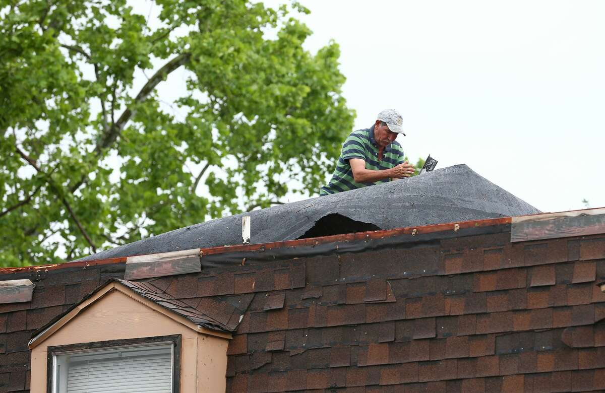 A man works on the damaged roof at the 5900 Bissonnet Street apartment complex after the severe weather Wednesday, March 29, 2017, in Houston. ( Godofredo A. Vasquez / Houston Chronicle )