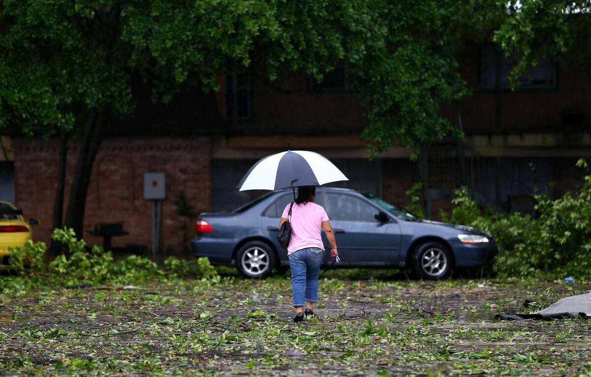 A woman walks through the parking lot at the 5900 Bissonnet Street apartment complex Wednesday, March 29, 2017, in Houston. ( Godofredo A. Vasquez / Houston Chronicle )