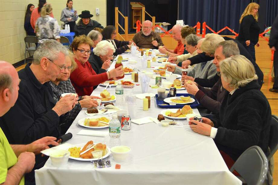 As much a social event as a fine meal was the St. Thomas Aquinas Church's 5th annual Fish Fry Dinner, Friday, Mar. 24, 2017, in Fairfield, Conn. Photo: Jarret Liotta / For Hearst Connecticut Media / Fairfield Citizen News Freelance