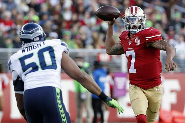 San Francisco 49ers quarterback Colin Kaepernick (7) passes against Seattle Seahawks outside linebacker K.J. Wright (50) during the first half of an NFL football game in Santa Clara, Calif., Sunday, Jan. 1, 2017. (AP Photo/Tony Avelar)