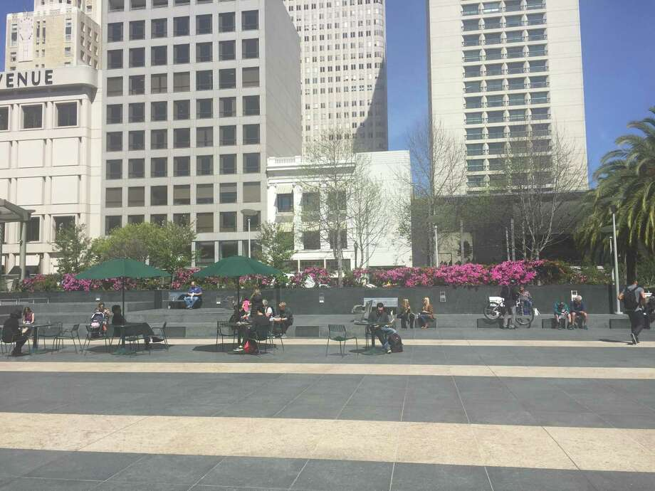 Some people took time to soak up the sun and enjoy clear skies Wednesday at Union Square in San Francisco. A warming trend this weekend is expected to send Bay Area temperatures into the 70s and 80s. Photo: Sarah Ravani / The Chronicle / /