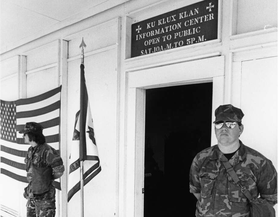 Guards stand in 1980 outside the Ku Klux Klan Information Center in Pasadena.