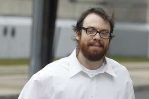 "FILE - In this Feb. 28, 2011 file photo, Andrew Auernheimer leaves the Martin Luther King, Jr. Courthouse after posting bail in Newark, N.J. Auernheimer, a notorious computer hacker and internet troll associated with The Daily Stormer, scoffs at the notion that anyone can be harmed by ""mean words on the internet."" For him, anonymous trolling is a modern form of a generations-old, ""distinctly American"" political tactic. (AP Photo/Julio Cortez. File)"
