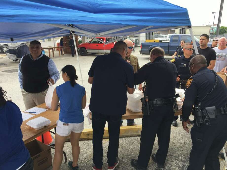 The San Antonio Police Department held a barbecue sale March 27, 2017, raising more than $20,000 in donations for Ofc. Cecilia Cantu's cancer treatment. Photo: Courtesy/San Antonio Police Department