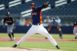Houston Astros starting pitcher Mike Fiers (54) works in the first inning of a spring training baseball game against the Miami Marlins Wednesday, March 29, 2017, in West Palm Beach, Fla. (AP Photo/John Bazemore)