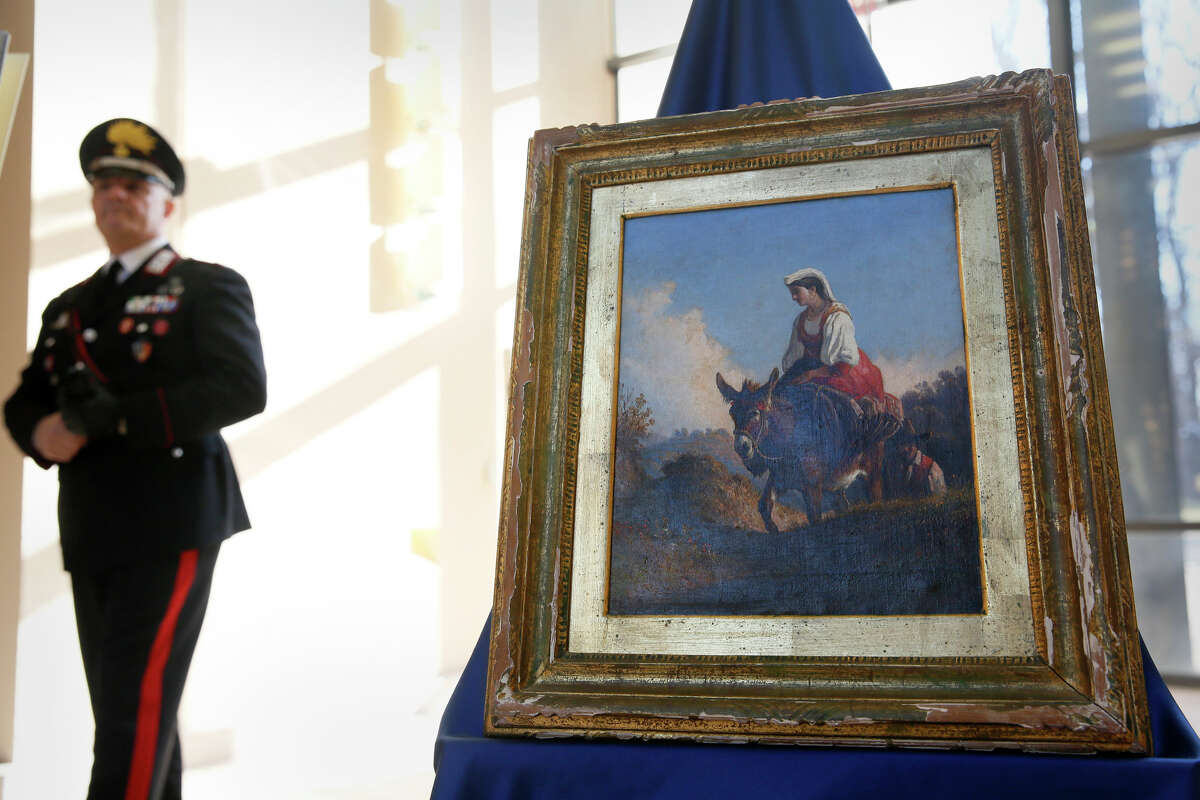 On a typical day in 2016, Customs and Border Protection: conducted operations in 51 countries, with more than 900 employees working internationally.Here, an Italian military police officer stands guard over a Consalvo Carelli painting during a repatriation ceremony at the Italian Embassy in Washington, DC, Dec. 9, 2016. The painting was stolen from a home in Naples in 2001 and later surfaced at a Pennsylvania auction house.