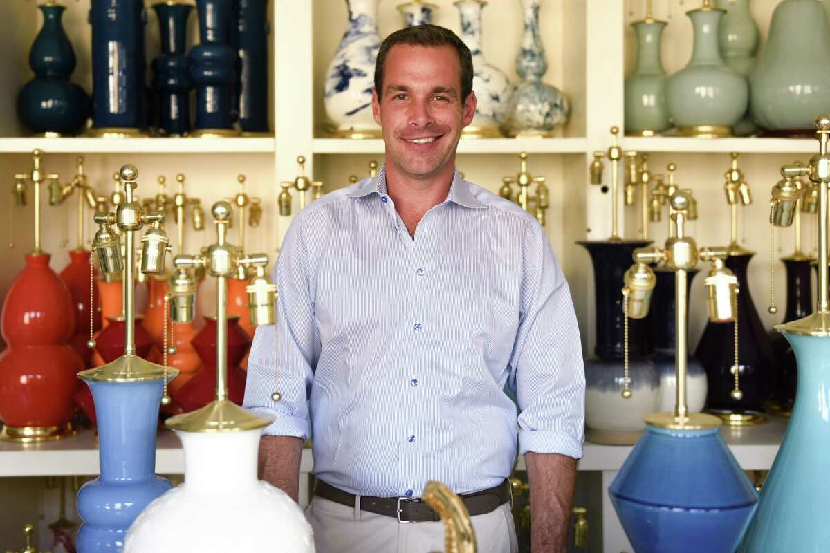 Ceramicist Christopher Spitzmiller poses among the lamps in his Manhattan store. He will be at Houston's Found home decor shop to meet customers from 10 a.m. to 5 p.m. on April 13, 2017.