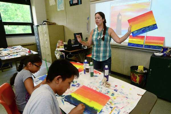 """Roton Middle School art teacher, Stephanie Bonner, instructs a class during the Roton Summer Academy at the school in Norwalk, Thursday, July 14, 2016. As the public school district prepares to transform its middle school structure at the beginning of next school year, concern has spread among teachers over """"an unsettling lack of honest discussion"""" from district officials as to what exactly that change will mean."""