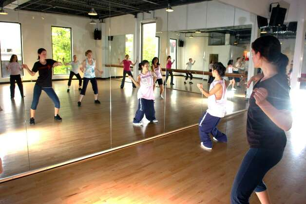 MJ Choi leads a jazz-funk dance and exercise class at