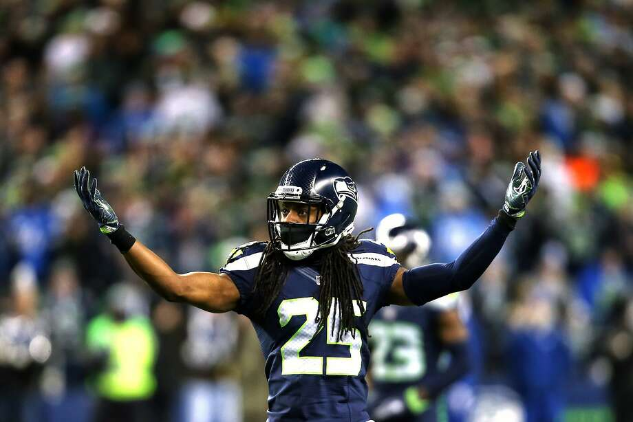 Seahawks corner back Richard Sherman gestures to the crowd during the first quarter of Seattle's NFL wildcard playoff game against Detroit, Saturday, Jan. 7, 2017, at CenturyLink Field. (Genna Martin, seattlepi.com) Photo: GENNA MARTIN, SEATTLEPI.COM