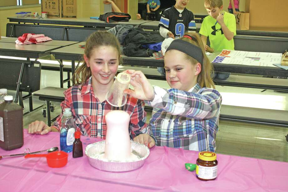 Sixth graders Katelyn Arntz and Isabel Learman are contestants in this year's annual Harbor Beach Science Fair for grades 4-8. Photo: Rich Harp/For The Tribune
