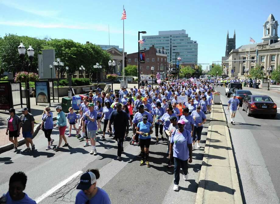 Folks flood the streets during a fund-raiser for CancerCare in Stamford in 2015. CancerCare will hold its fifth annual walk/run in Greenwich on Sunday. Photo: Tyler Sizemore / Staff Photographer / Greenwich Time