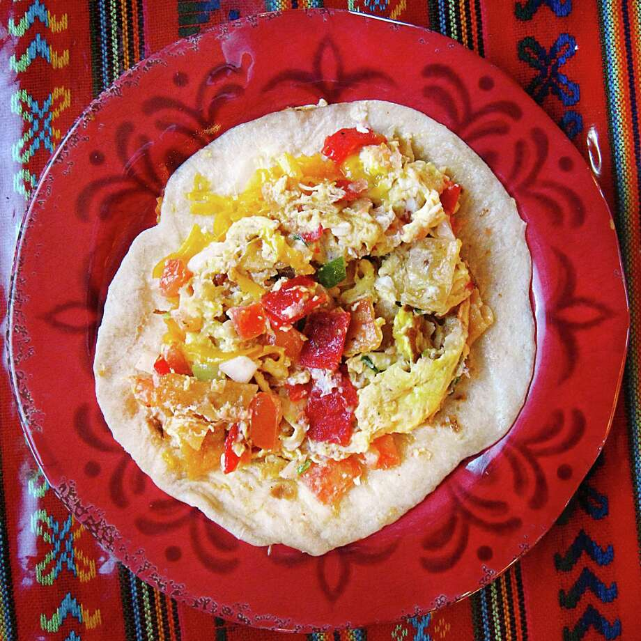 Week 13 Taco of the Week: Chilaquiles taco on a handmade flour tortilla from Los Campos Dos Hermanos on West Military Drive. Photo: Mike Sutter /San Antonio Express-News