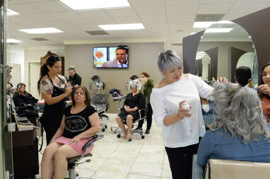 Naty Longoria,  right foreground, worries that the closing of Macy's in Pasadena will affect businesses at her establishment, Naty Salon and Spa.SLIDESHOW: Brands that are predicted to fail in 2017