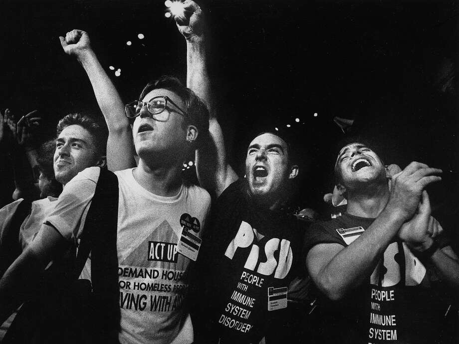 Putting political statements on T-shirts has a long history in the Bay Area. Shirts from the AIDS direct-action group ACT UP were a common sight at protests during the 1980s and 1990s. Photo: Scott Sommerdorf, The Chronicle