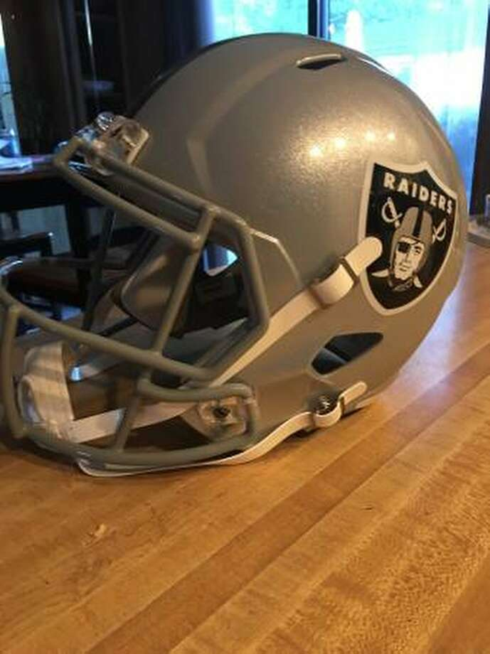 A Raiders fan has vowed on Craigslist to burn his team gear, including this Riddell helmet, this weekend unless it is sold beforehand. Photo: Craigslist