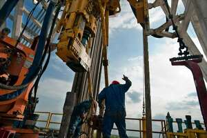 A floor hand works on an Eagle Ford Shale rig. BP's find produced more natural gas than Eagle Ford wells.