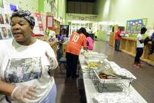Toneria Dix of Stamford, who volunteers as a Parent Coordinator during the Summer Night Basketball Program at the Yerwood Center in Stamford, Conn., talks about her involvement  on Aug. 10, 2016. She and fellow volunteer Evelyn Fisher just fed over 100 young men and teens Curry and BBQ Chicken with White Rice, Cabbage and Corn Bread meal during a family night get together.