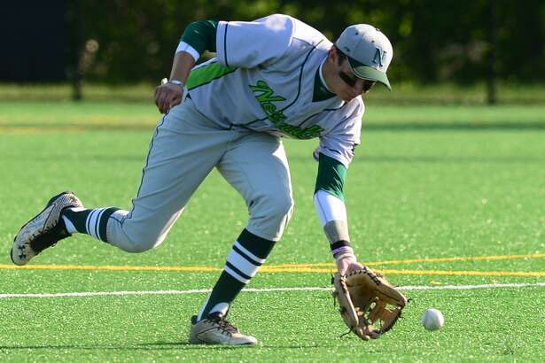 Norwalk shortstop Eddie McCabe gets his glove on the ball in an FCIAC quarterfinal game against Ridgefield on May 20.
