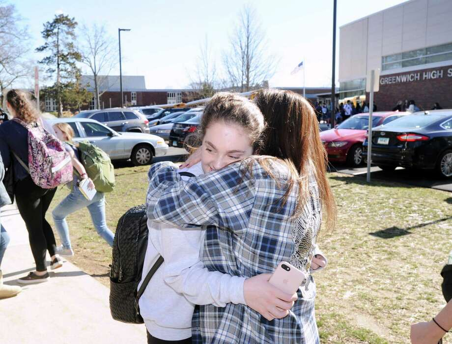 Greenwich High School freshman Amanda Friedman,15, hugs her mother Heather Friedman after a lockdown at the school on Wednesday afternoon.. Photo: Bob Luckey Jr. / Hearst Connecticut Media / Greenwich Time